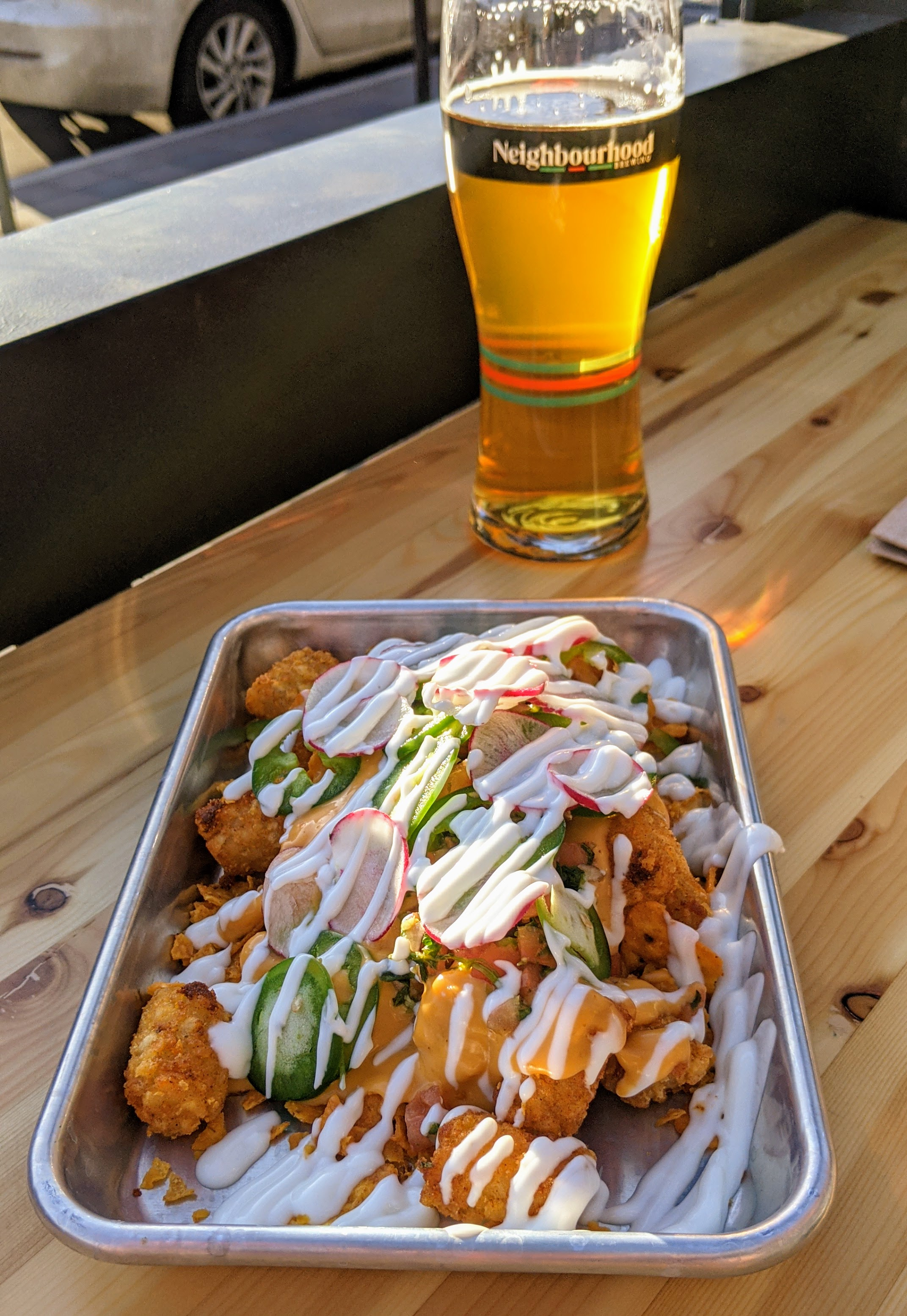 Tatchos (tater tot nachos) at Neighbourhood Brewing