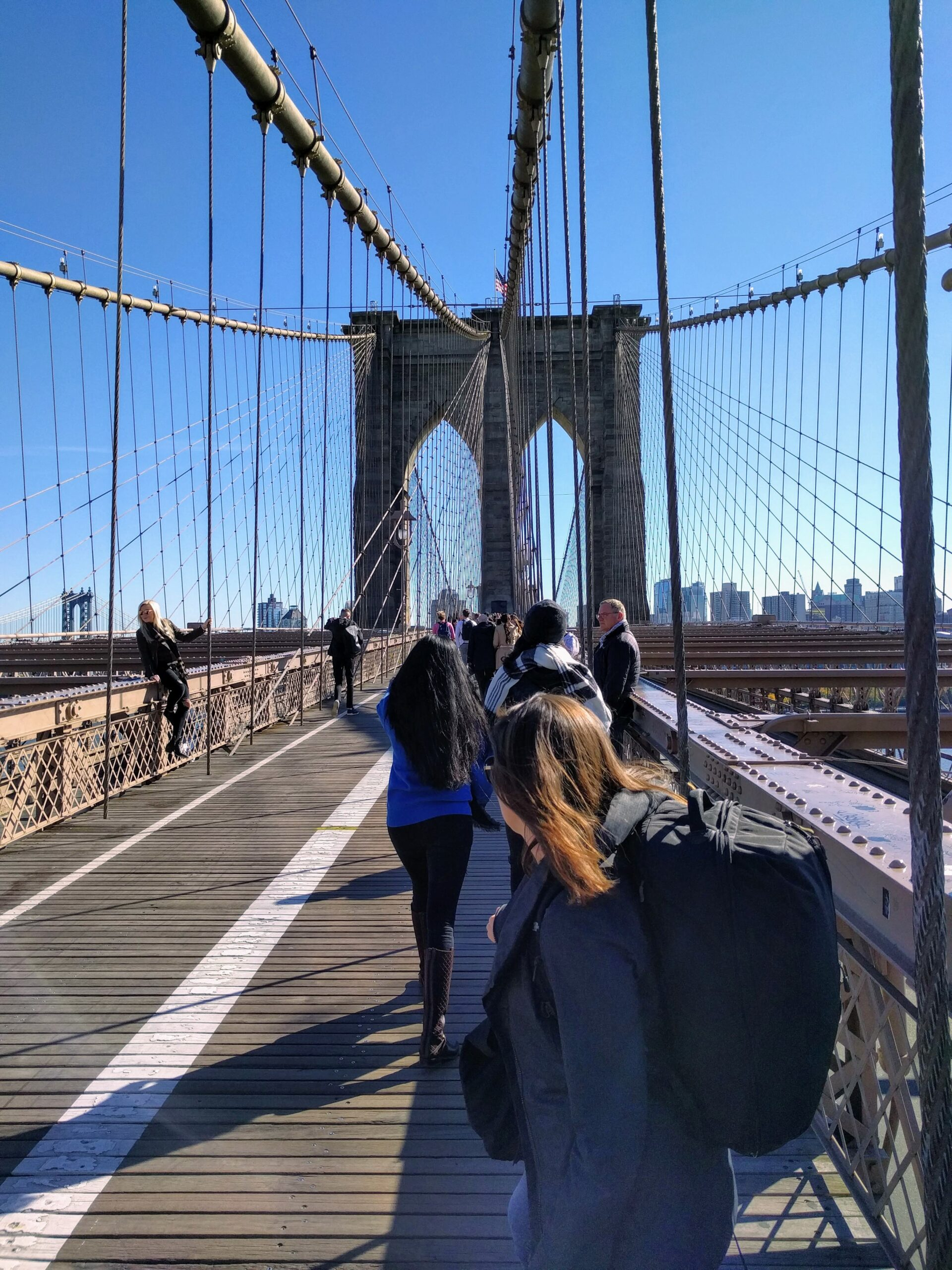 Walking across the Brooklyn Bridge with our MEC Shuttle II bags