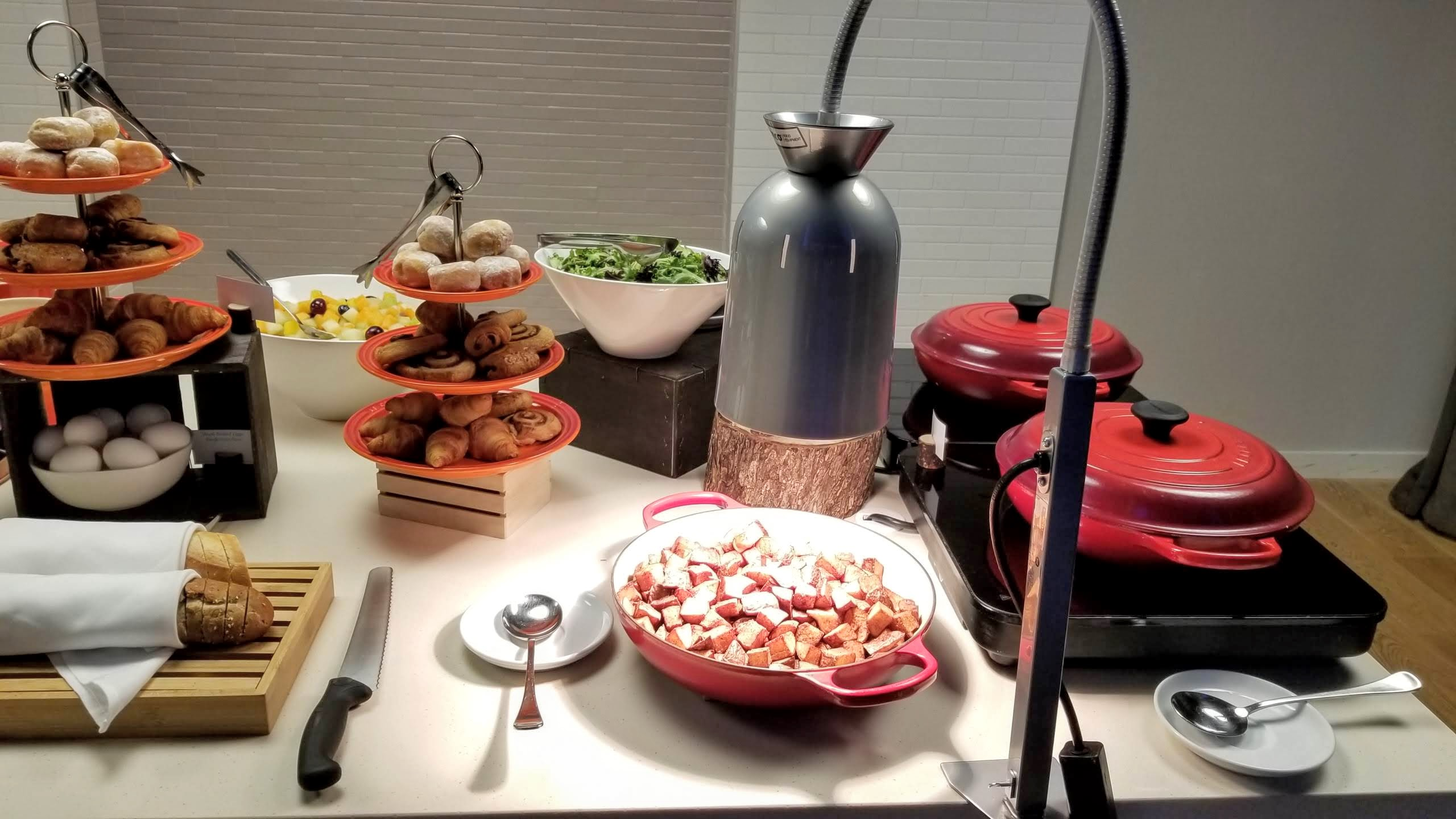 Food at the complimentary continental breakfast: potatoes, oatmeal, salad, fruit salad, and pastries