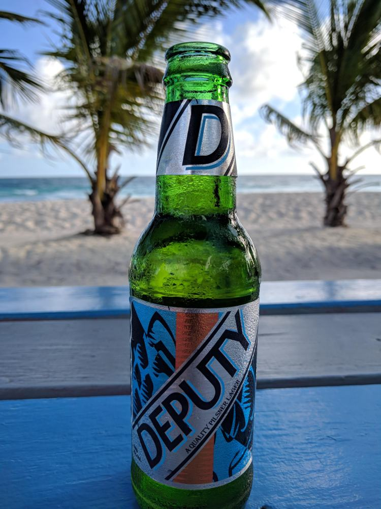 Enjoying a Deputy Pilsner at Chill Bar on the beach in Hastings.