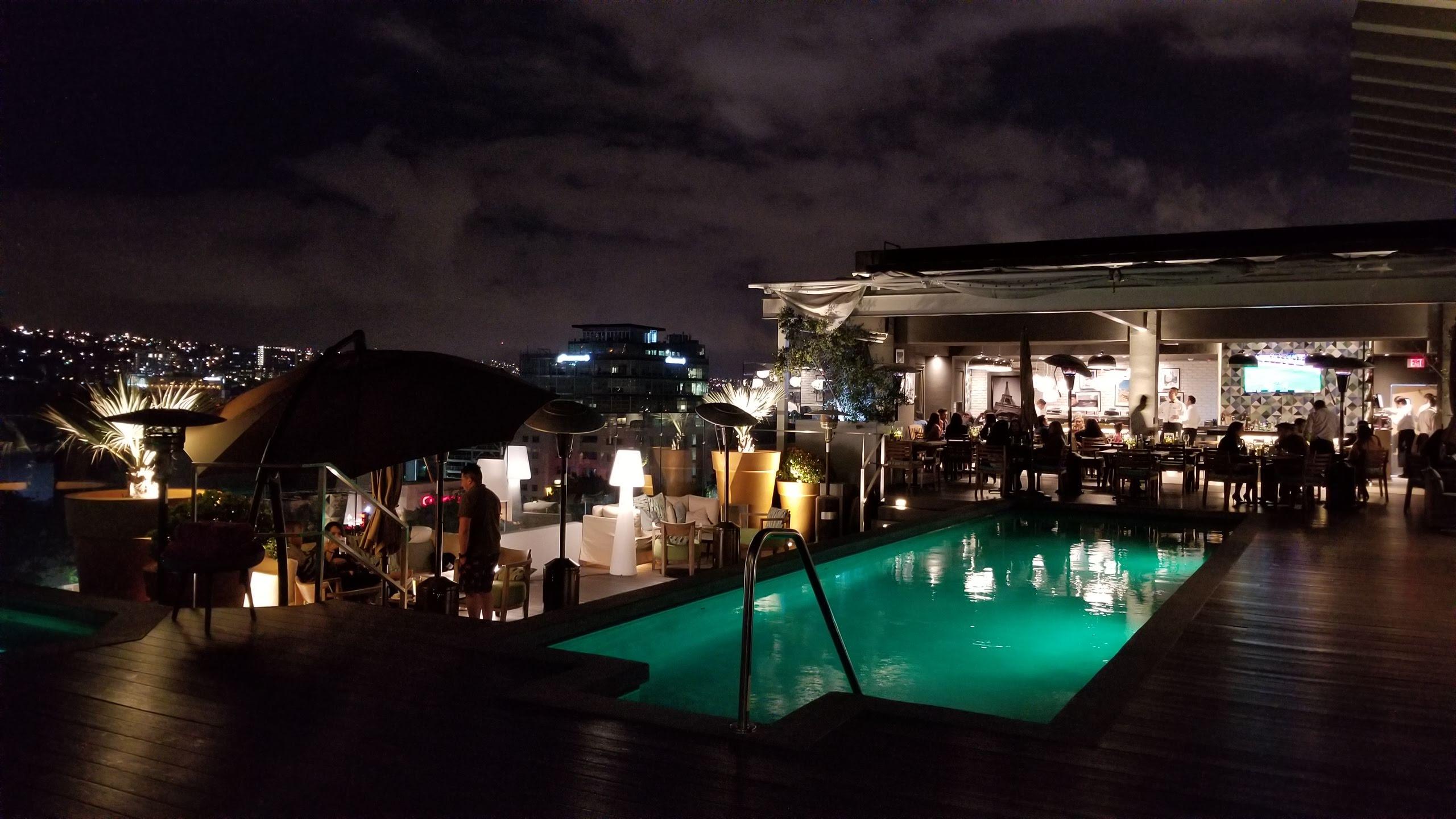 Rooftop pool and Sushi en la Azotea at night