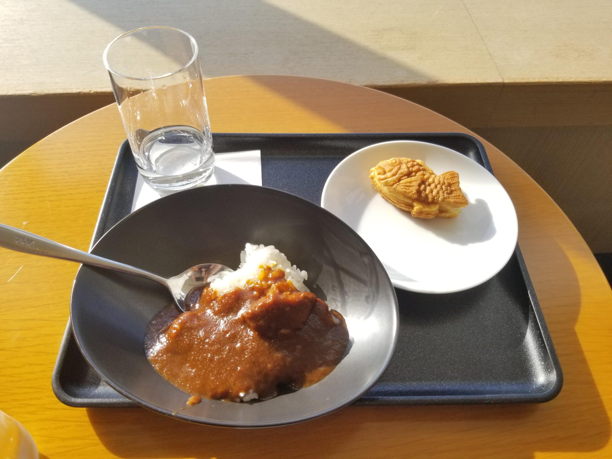 Japanese curry and takoyaki at the JAL Sakura Lounge at Tokyo Narita