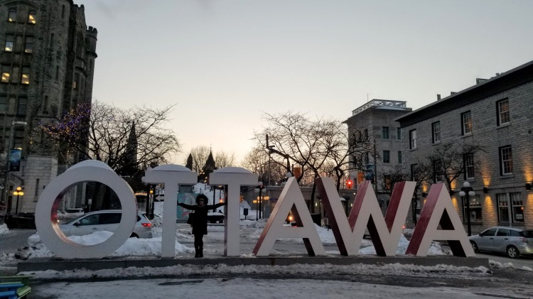 Max in front of the Ottawa sign in the ByWard Market in -24 Celsius winter cold