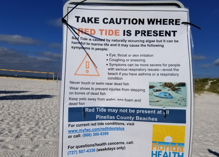 Sign posted about the Red Tide