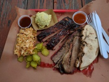 Brisket, turker, ribs, potato salad and slaw at La Barbecue