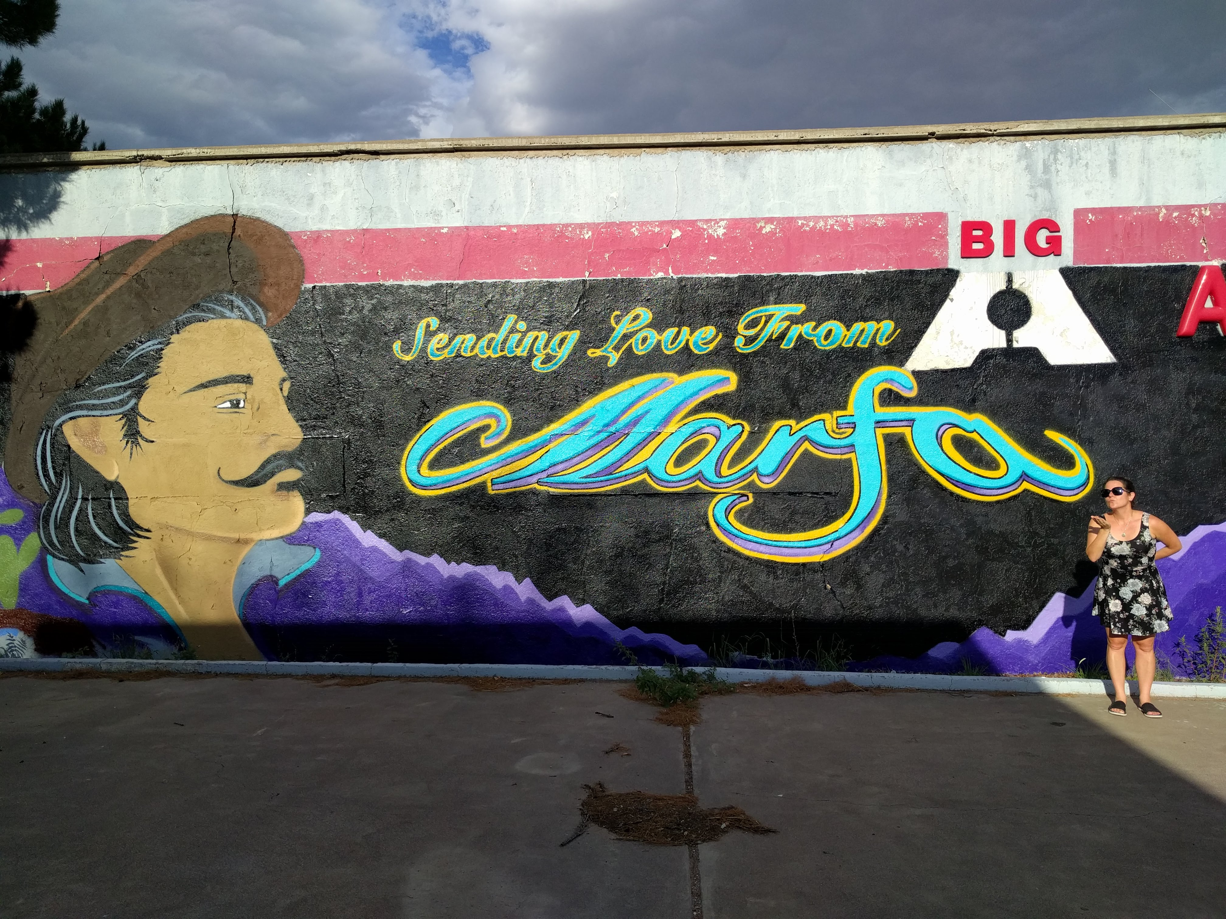 Max and a mural in Marfa