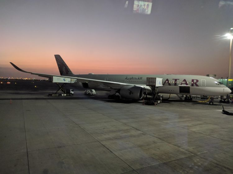 A Qatar Airways aircraft being serviced at DOH - Hamad International Airport