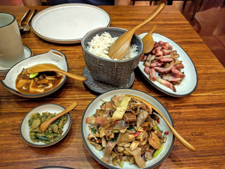 Meal: smoked pork, stir fried banana blossom salad, grilled squid in sauce, and sambal