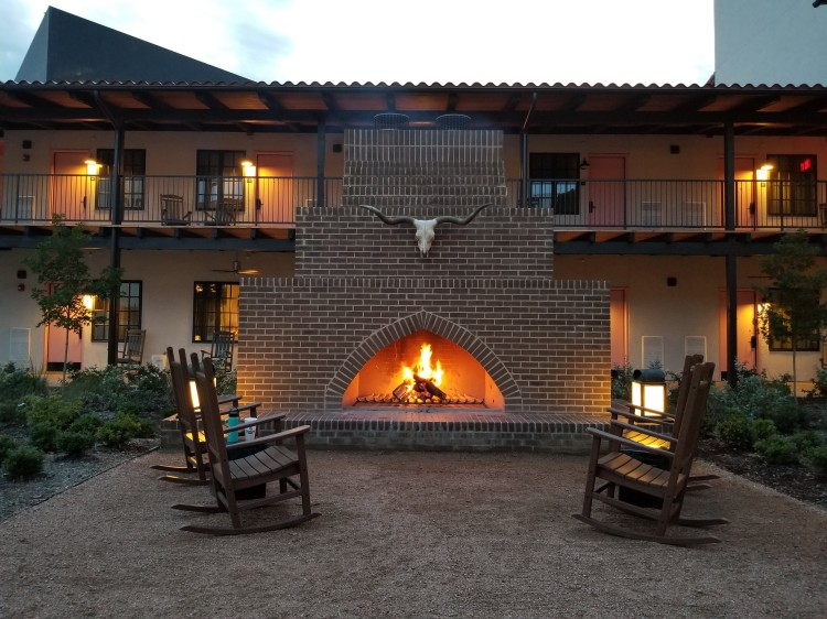 Fireplace and rocking chairs at Texican Court