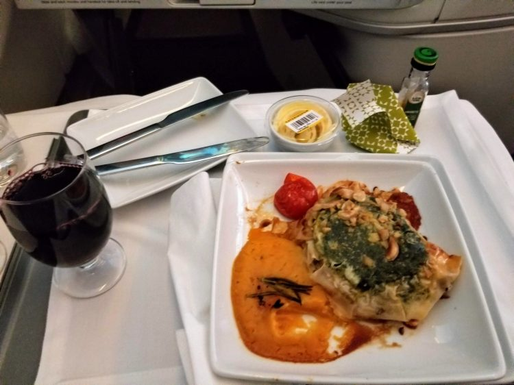 TAP Air Portugal's A330neo from LIS to EWR: main dish of roasted lamb in pastry with pumpkin puree, spinach and hazelnuts