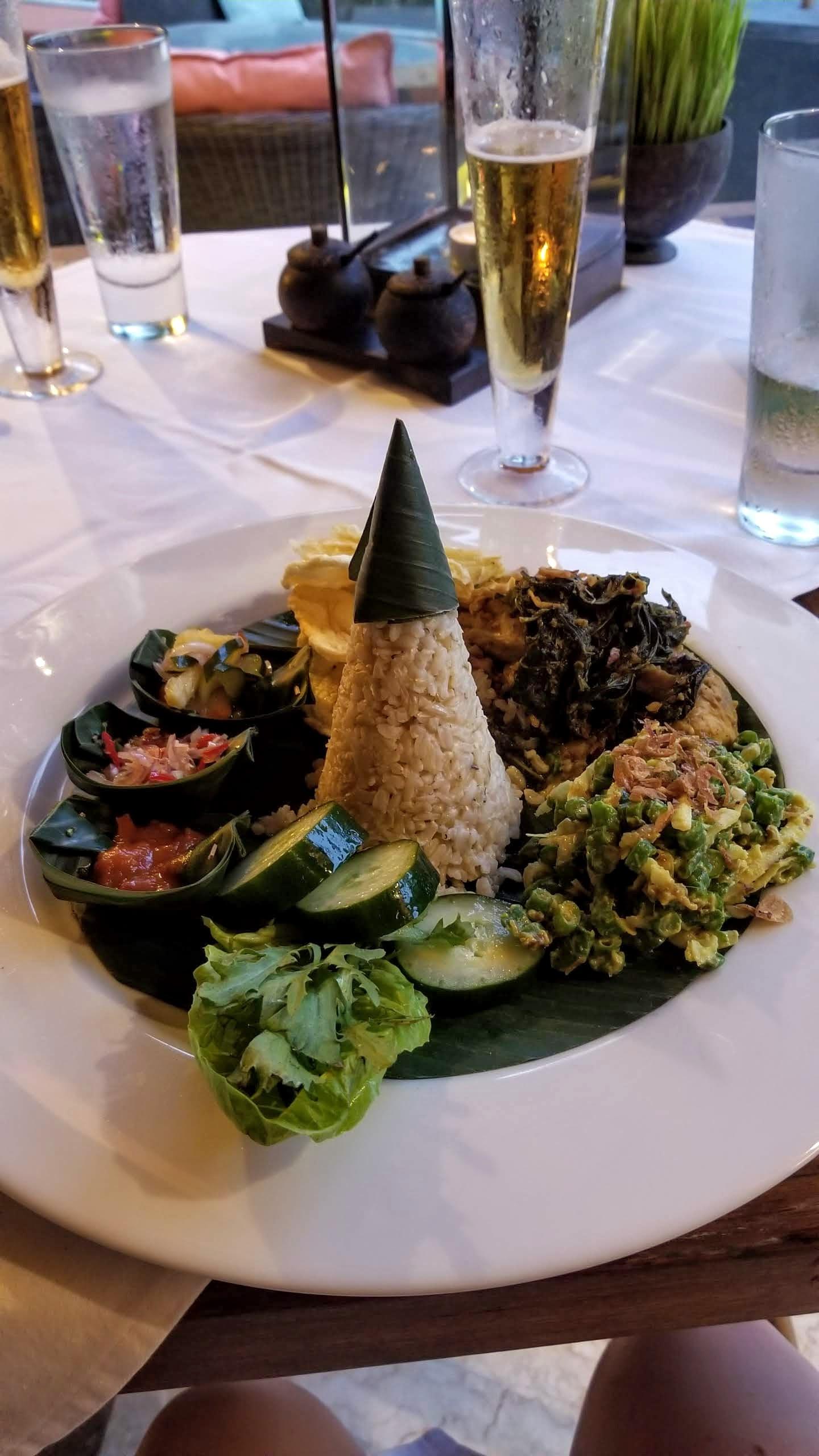 Chicken dish served with Balinese sambals, rice, and veggies