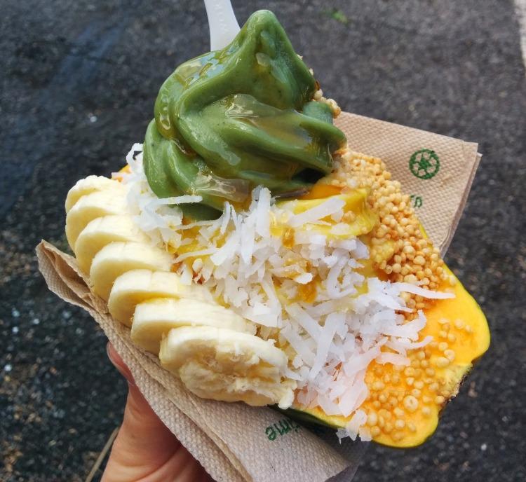 Banan in a papaya boat with toppings