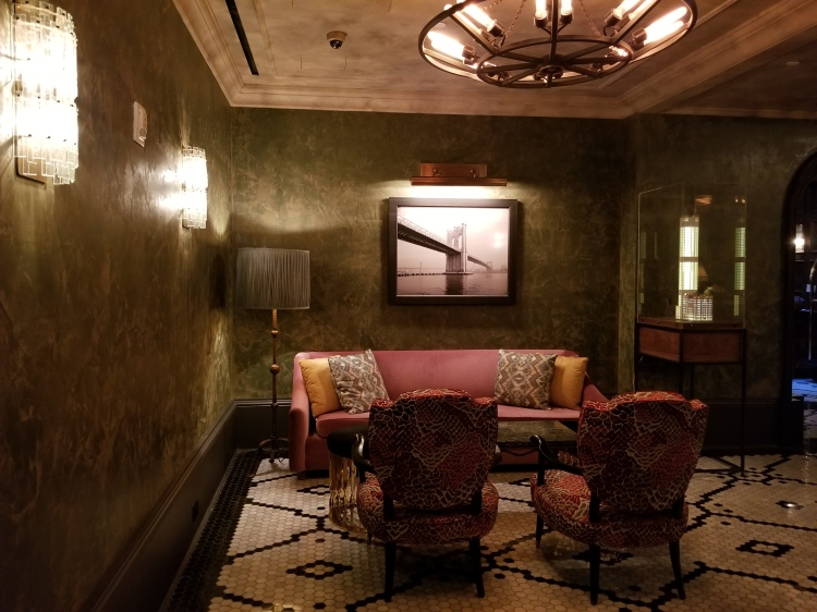 Seating area by the concierge desk in The Beekman Hotel