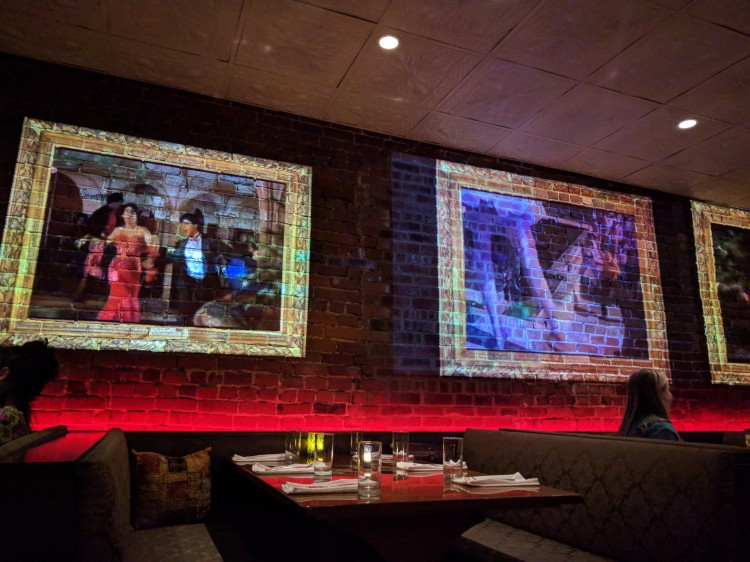 Bollywood wall projections at Chauhan Ale and Masala House