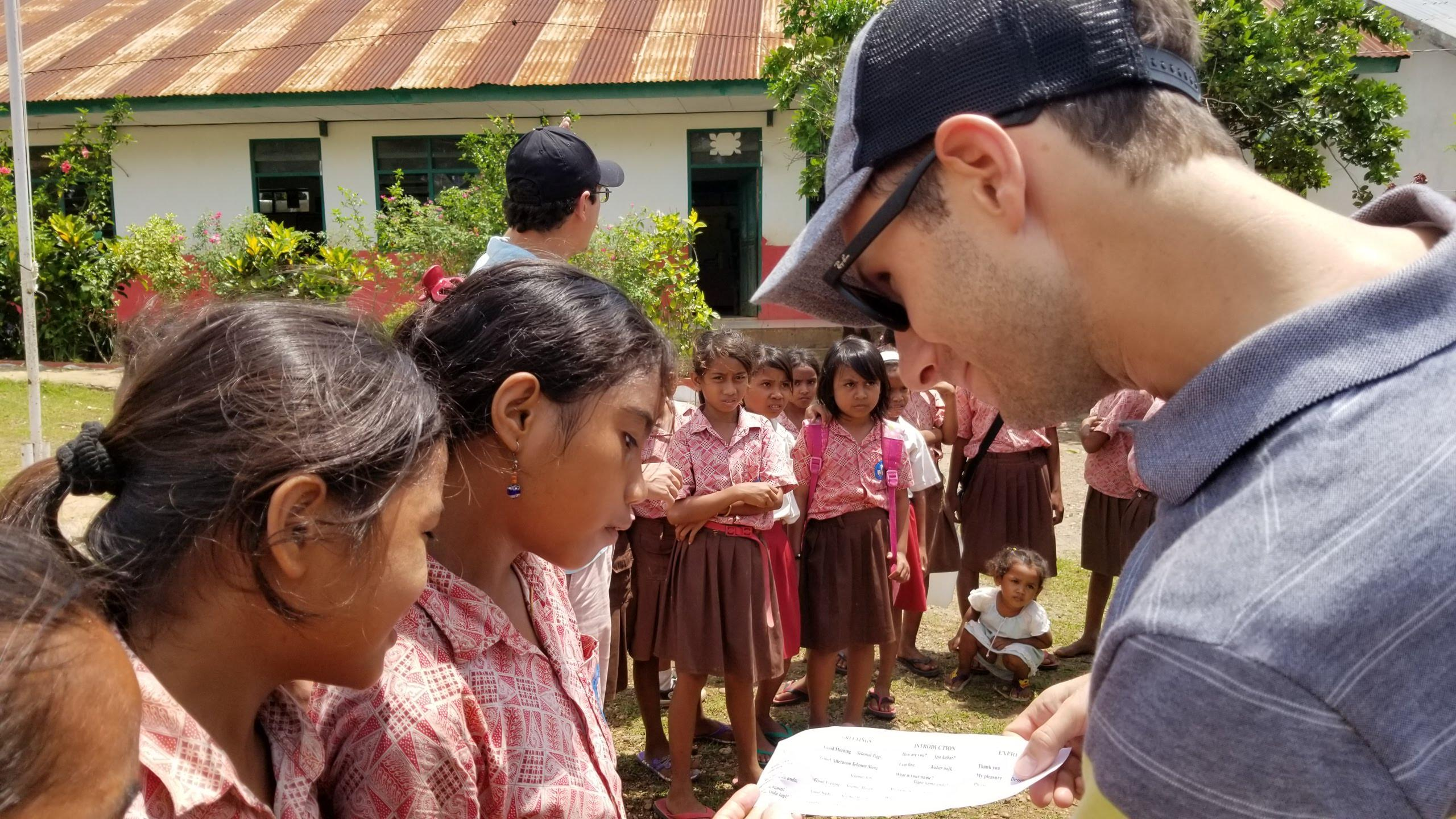 Jason chatting with the kids in English and Bahasa