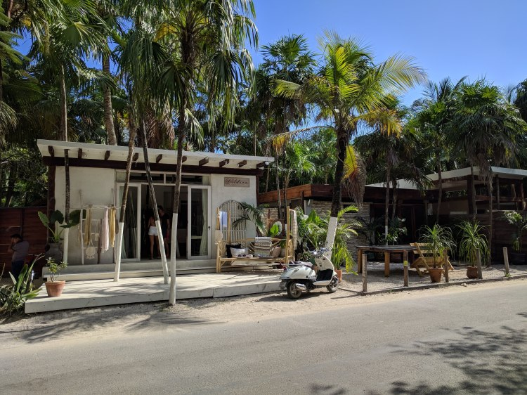 A motorbike and shop in Tulum