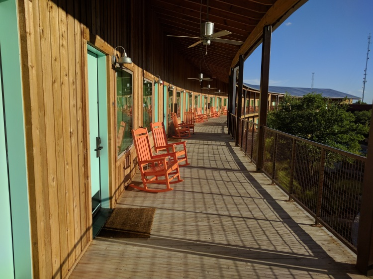 Top floor deck with rocking chairs