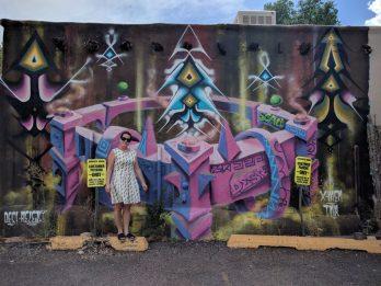 Max and a mural in Santa Fe