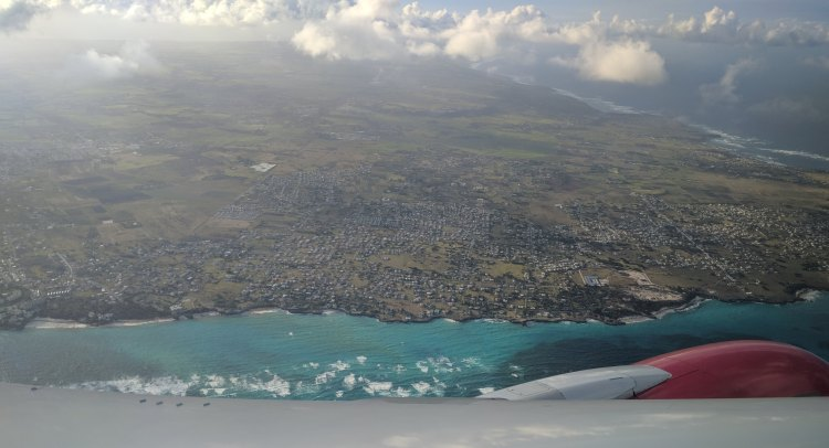 Taking off from BGI and a view of the Island