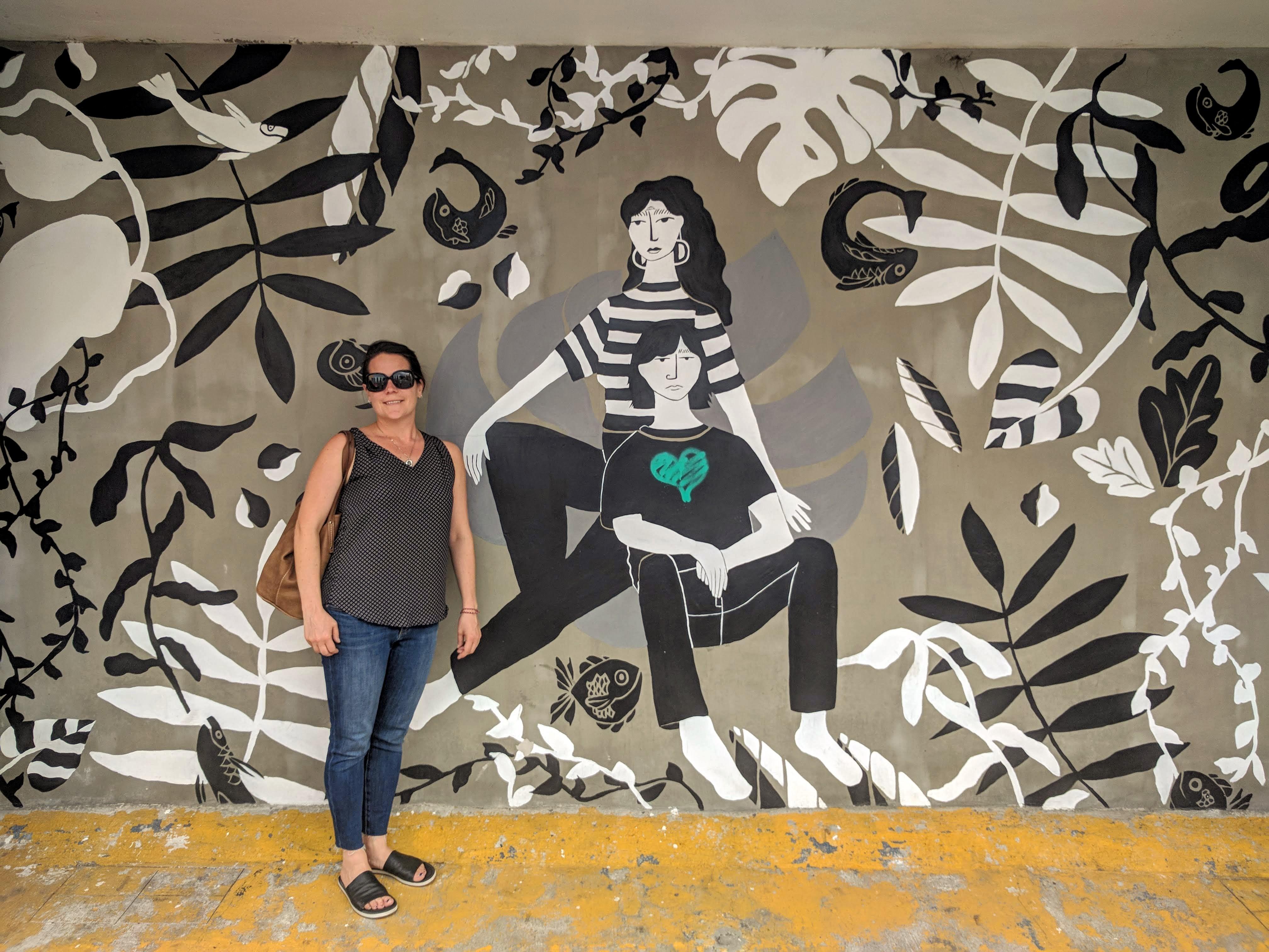 Max beside a mural in Guadalajara