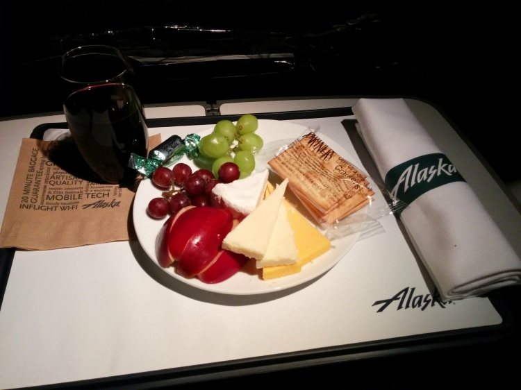 The Alaska Airlines Fruit and Cheese Plate with a glass of Browns Cabernet.