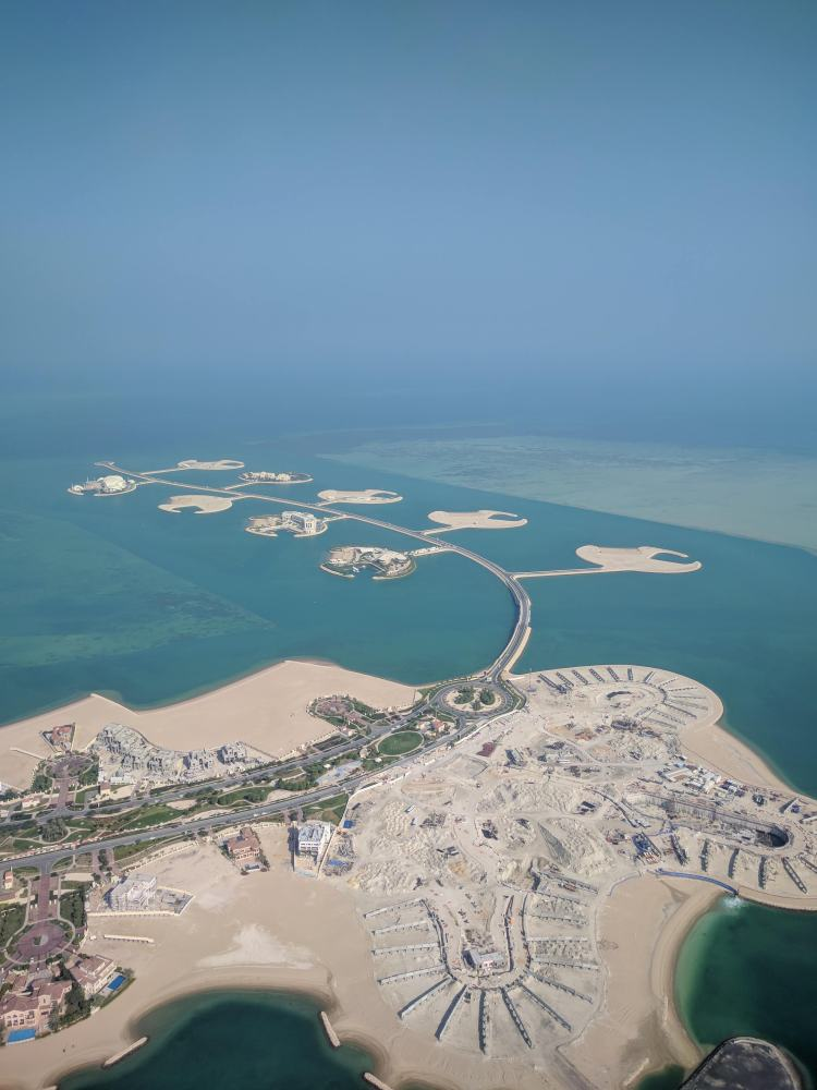 Flying over an island near Doha
