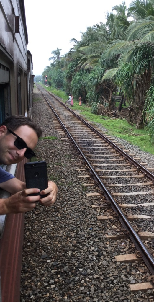 Jason taking a photo of me hanging out of the train