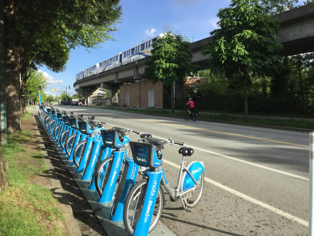 Mobi Bike Share and the Sky Train by Commercial Drive