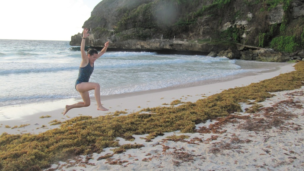 Me jumping over some sargassum seaweed on Crane Beach in Barbados