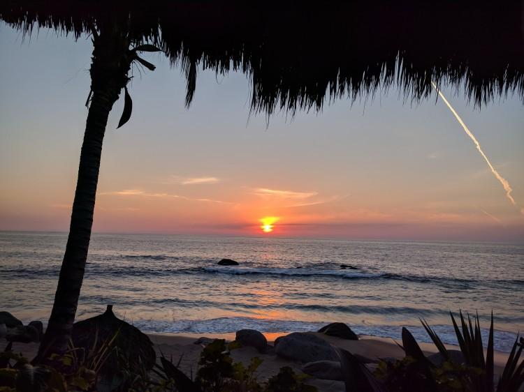 Sunset at happy hour at Playa Escondida