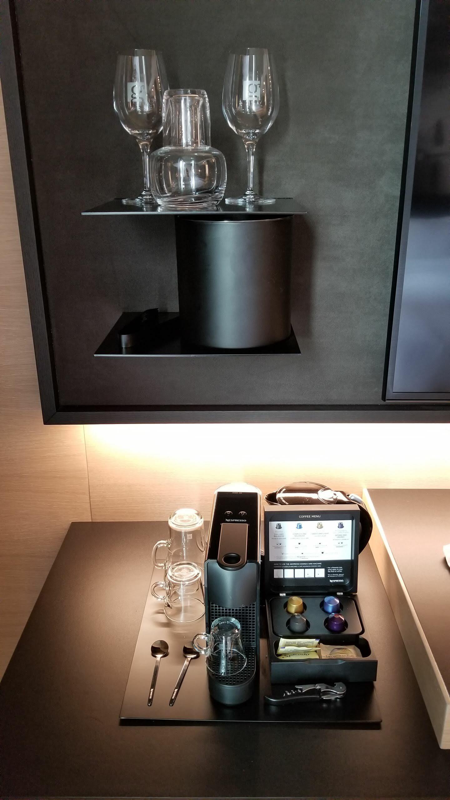 Wine decanter, wine glasses, and Nespresso machine
