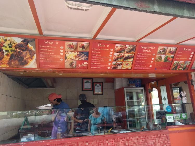 Menu and food counter at Sahara Arabic Grill and Falafel