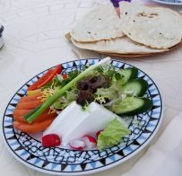 Welcome appetizer of cheese, flat bread and vegetables at Parisa's Sharq Village Location
