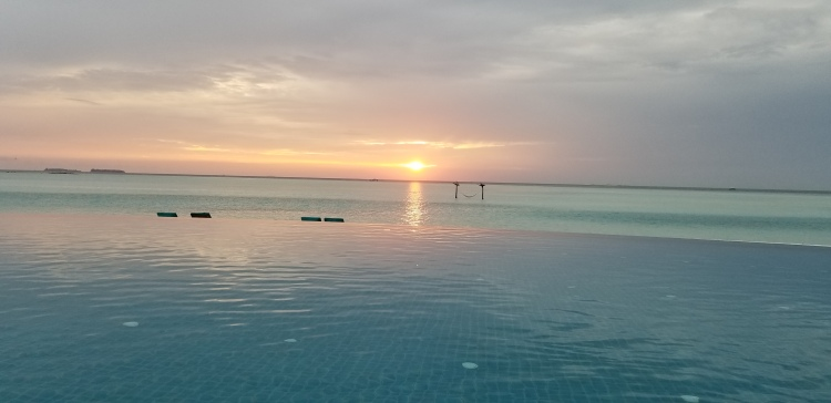 Sunset from the infinity pool at the Anantara Dhigu