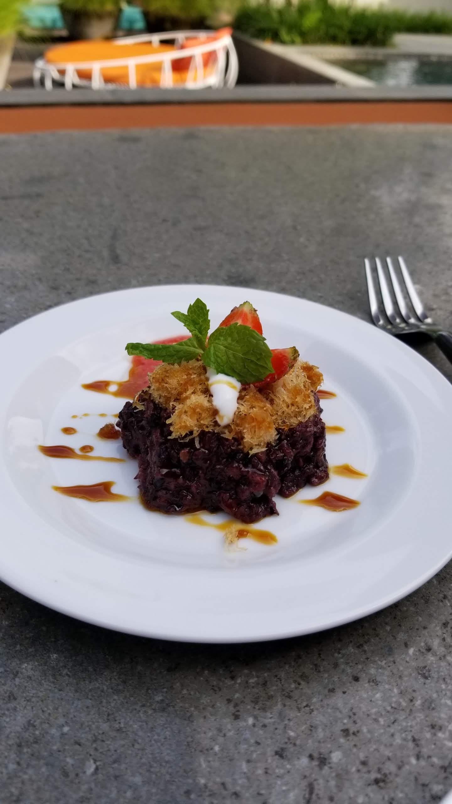 Black rice dessert served at tea time