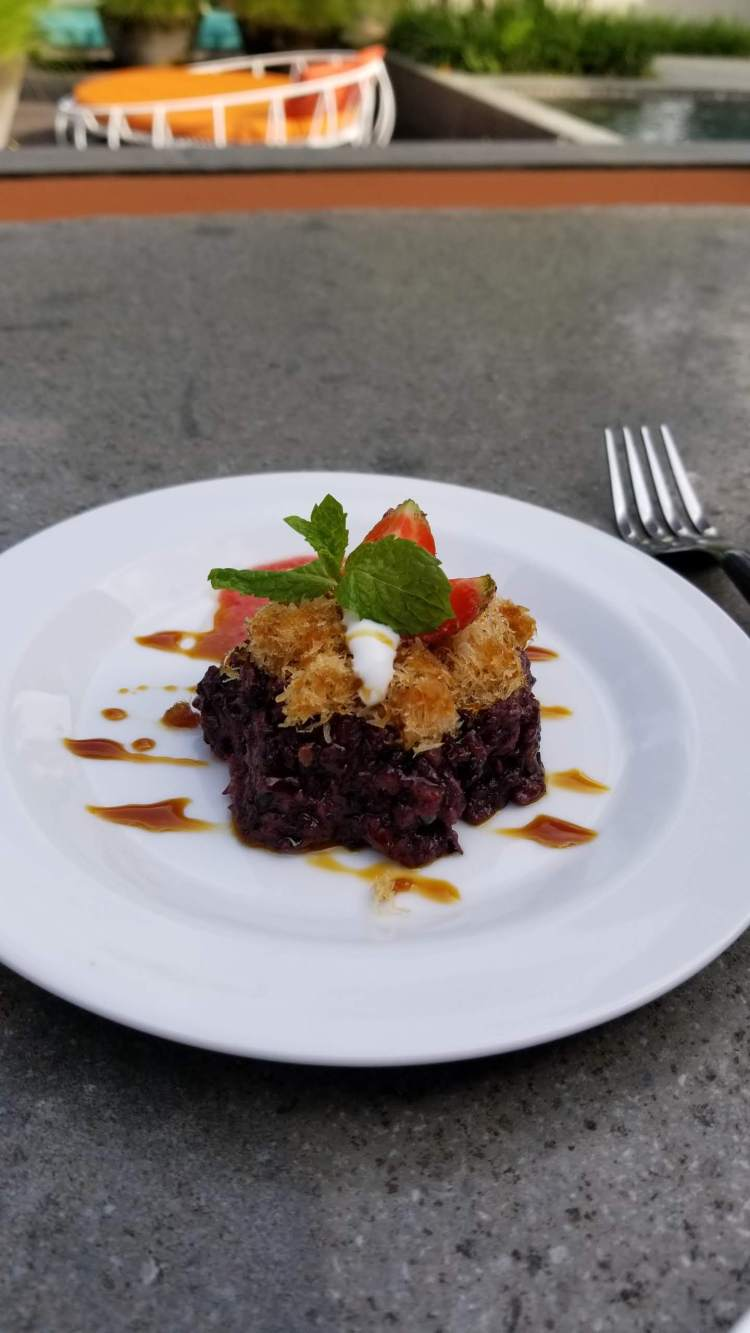 Black rice dessert served at tea time