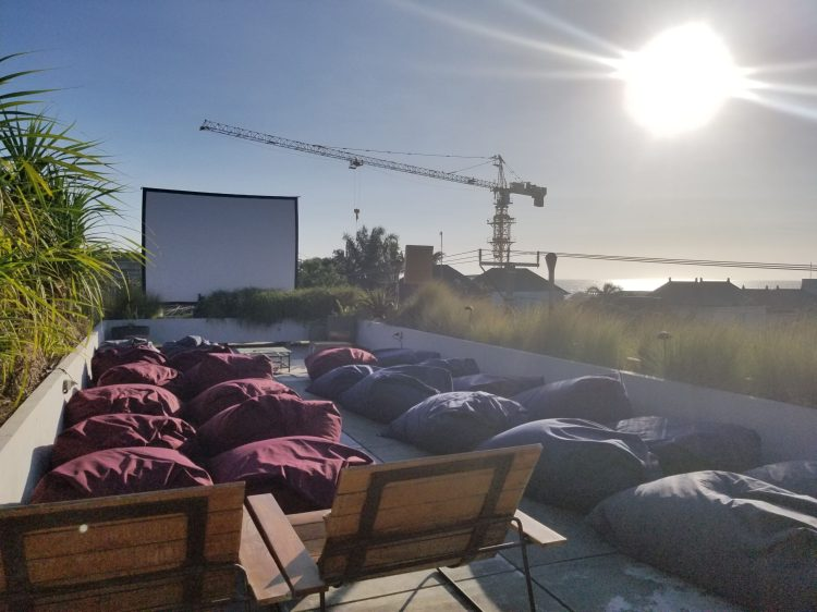 The Slow - Outdoor movie night on the rooftop