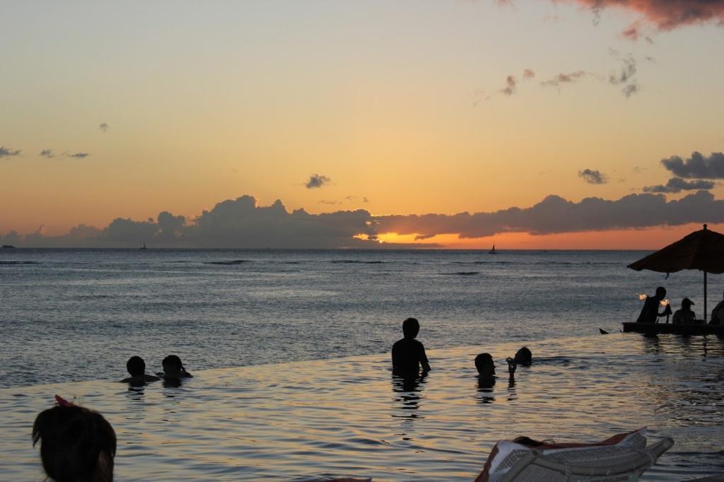 Adult infinity pool at sunset at the Sheraton Waikiki