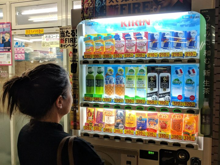Max in awe of a Japanese vending machine in Tokyo