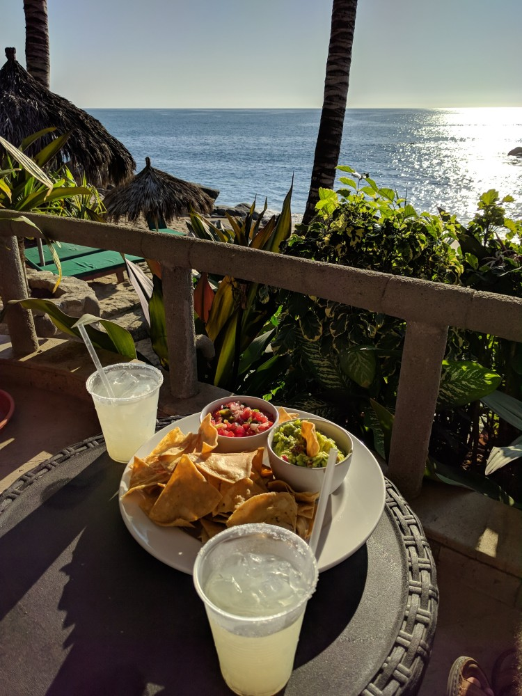 Happy hour margaritas and chips and gucamole with pico de gallo