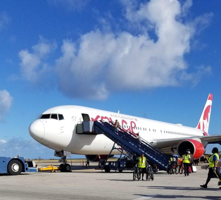 Boarding Air Canada Rouge 1715 at BGI