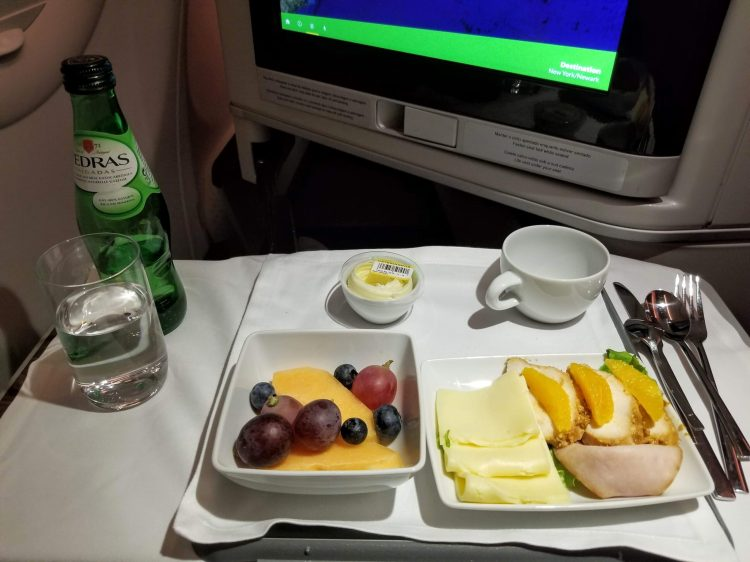 TAP Air Portugal's A330neo from LIS to EWR: arrival meal of fruit and a plate of cold cuts and cheese