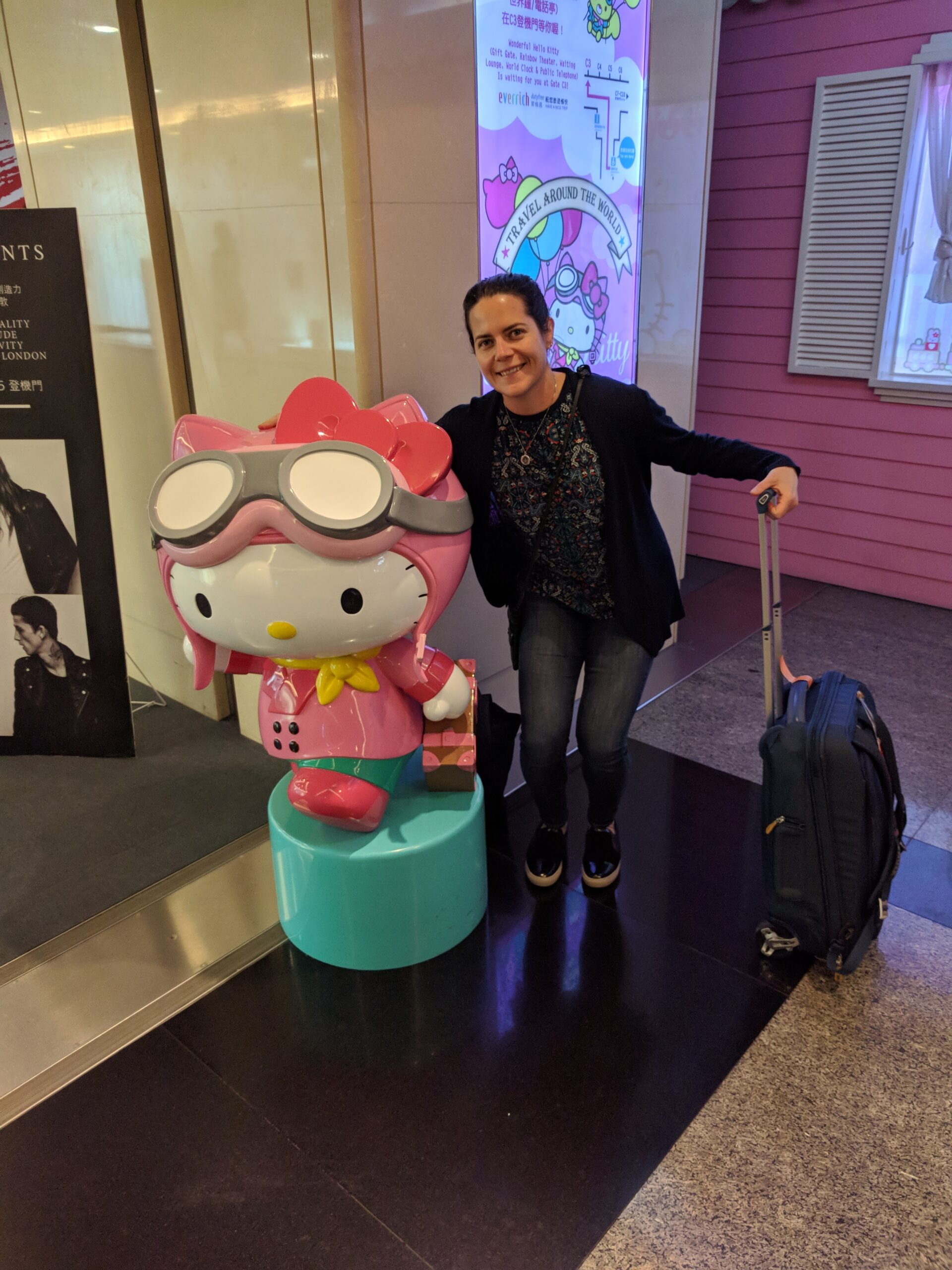 Max, Hello Kitty, and the Thule bag at Taipei Airport
