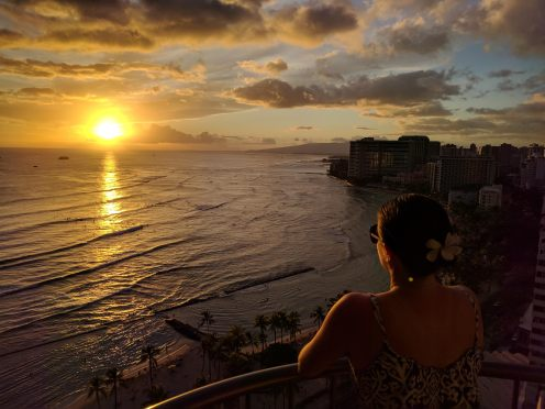 Max watching the sunset from our balcony at the Waikiki Marriott