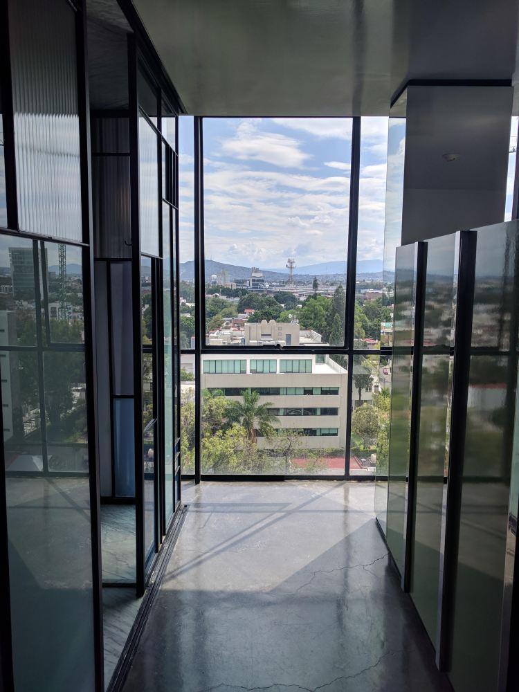 Floor to ceiling windows in a Deluxe room at Casa Habita in Guadalajara