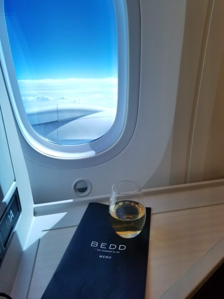 Champagne at 40,000 feet in JAL Business Class on the 787-900 Sky Suite III