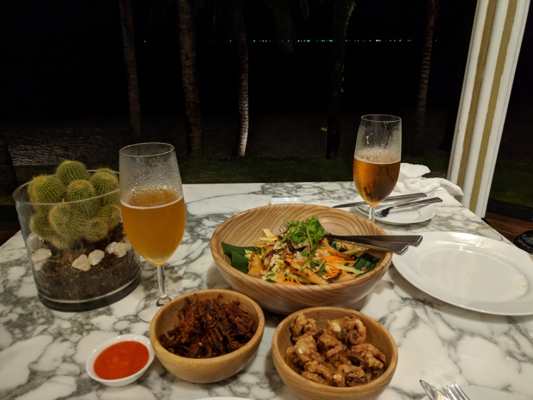 JW Marriott Phu Quoc Resort at Emerald Bay - Dinner at the resort: squid, seafood mango salad, and spicy beef jerky with Pasteur Brewing craft beer