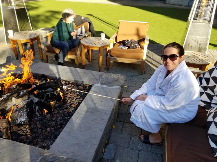 Maxine roasting a marshmallow