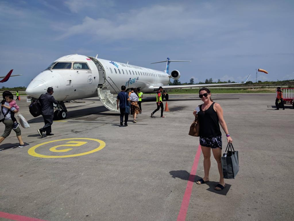 Max at Tambolaka Airport in front of a Garuda Indonesia CRJ