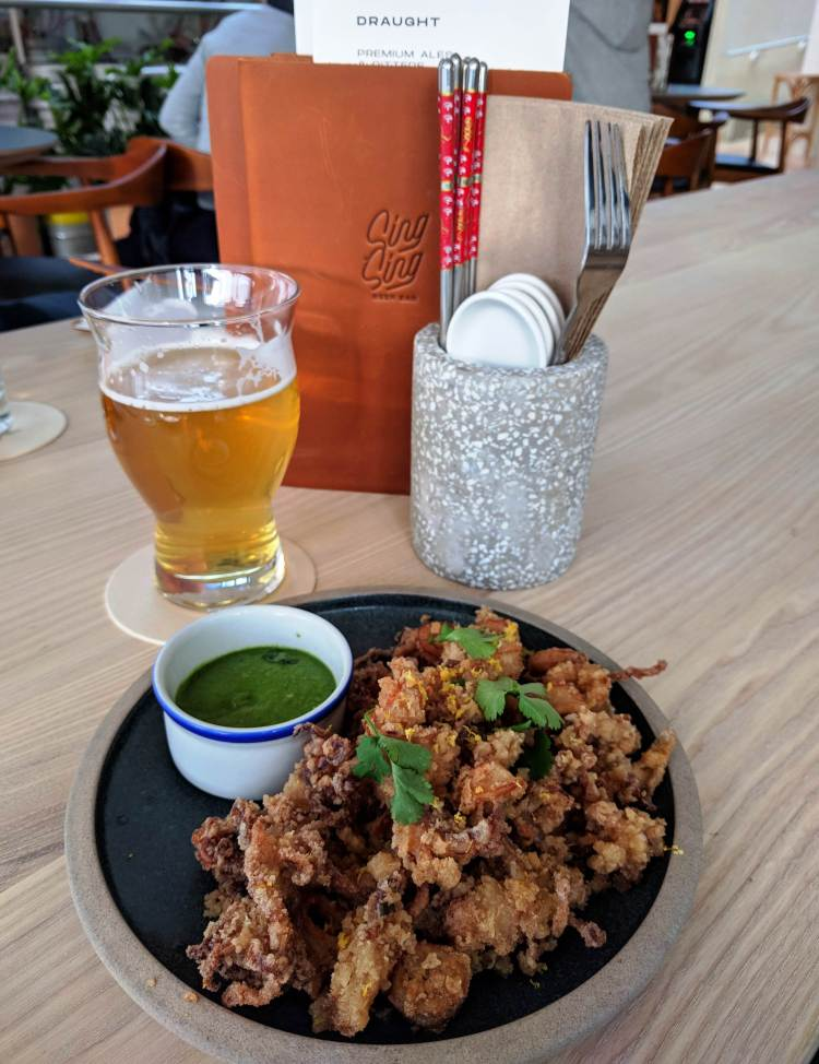 A Phillips Electric Unicorn White IPA ($4) and the calamari ($8)